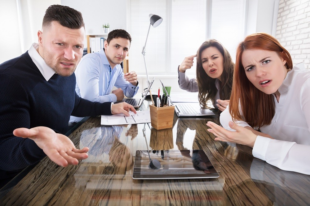Business Executives Complaining In Office